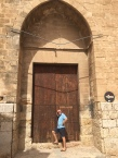 C3. Ian at church door, Pollensa 13.7.18.